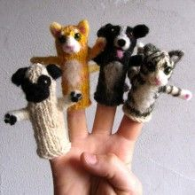 Cats and Dogs finger puppets. Check out the pug!