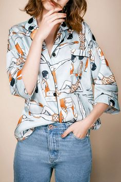 loving this pajama style blouse with a lounging lady swimmers print in two of my favorite colors, pale aqua and bright orange. gimme.