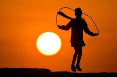 Skipping in the sunlight ... Photograph: Raed Qutena/EPA