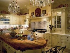 kitchen design ideas.  I like the shelves above the cabinets and one of the built in china cabinet