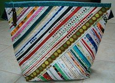 Selvage Blog: selvage tote bags...if you're like me you always check out the selvage art ( this is where the designer has a dot of each color in the fabric printed [color theme] and other info. Usually thrown away-what a waste!