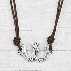 "Double horseshoes with a turquoise accent bead say ""horses give you wings"" etched on the back. Find more of our horse inspired jewelry at islandcowgirl.com."