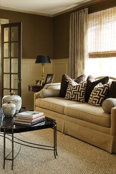 ML Interior Design: Chic formal living room with brown paint color paired with creamy white board and batten ...