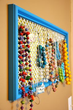20 minute crafter-upcycled jewelry display frame. a good idea if i had any idea where to get that kind of mesh?