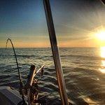@huntercoats619 took this awesome sunset shot while fishing on Lake Michigan #visitgrandhaven #grandhaven #lakemichigan #fishing #puremichigan #midwestmoment