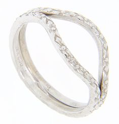 Floral designs cover the surface of these 14K white gold curved wedding bands. Their shallow, long curve makes them perfect for engagement rings more complex than a single stone. Photographed here with R1589 (sold separately) the antique style rings each measure 5mm in width including the curve. Size: 7 3/4. We can re-size. The bands are frequently purchased as a set for $480.00 but they are also available individually for