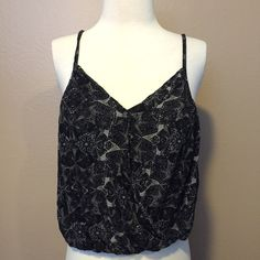 Free People black top Perfect for summer this is a very nice shirt in great condition. It has an elastic bottom to give the shirt a loose look. The back has a simple but cute design and the sides are crochet. The size is xs but can fit a medium. I get all my shirts in Medium and that fits perfect! Free People Tops