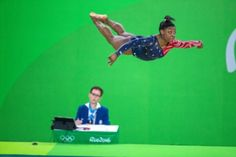 Simone Biles of the United States performing her floor routine during the Artistic Gymnastics Women's Qualification round at the Rio Olympic Arena on August 7, 2016 in Rio de Janeiro, Brazil. (Photo by Tim Clayton/Corbis via Getty Images)