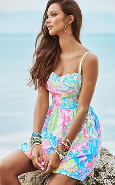 """This Lilly Pulitzer Ardleigh Sundress in Multi Lovers Coral is the flirty, fun summer dress you've been waiting all year to wear. - Smocking, Side Seam Pockets And Built-In Cups - 18.5"""" From Natural W"""