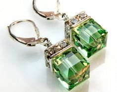 Peridot crystal earrings are handmade with bright apple green cube Swarovski crystals. The crystal color mimics the gemstone peridot. Peridot Earrings, Drop Earrings, Peridot Jewelry, Earrings Photo, Emerald Earrings, Chandelier Earrings, Green Earrings, Silver Earrings, Make Jewelry