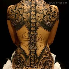 Love the skulls going up the spine with the negative corset.