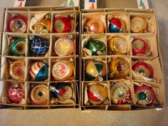 Vintage Shiny Brite ornaments in their original boxes. There are reproductions out there but these appear to be the originals.