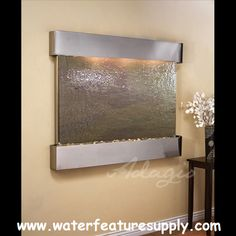 Provide a valuable detail to your living room with the use of this indoor wall water fountain. Stainless steel finish round-edge hood and tray. Style # at Lamps Plus. Tabletop Water Fountain, Indoor Fountain, Jacuzzi, Indoor Waterfall Wall, Stone Fountains, Wall Fountains, Waterfall Features, Water Walls, Outdoor Walls