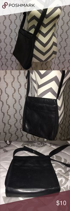Nine West Purse Black. Multiple pockets.  Canvas and leather. Adjustable strap. Gently used. Small white mark on the back...see pictures. Nine West Bags Shoulder Bags
