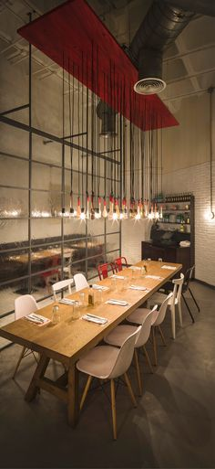 Restaurante Ginos | light feature lights and baking implements #suspended #lighting #restaurant #red