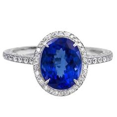 Fancy Oval Tanzanite Platinum Ring | From a unique collection of vintage cocktail rings at https://www.1stdibs.com/jewelry/rings/cocktail-rings/