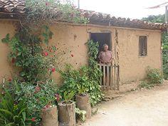 A casa de Dona Maria, na margem do Rio Cipó, em Minas