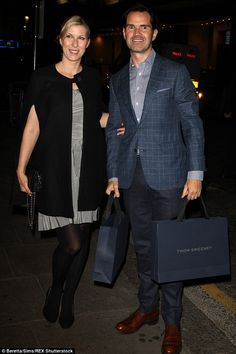 Gifts galore:Jimmy Carr and long-term girlfriend Karoline Copping arrive at the party arm...
