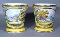 A Pair of Coalport Yellow-ground Cache Pots and Stands with Pastoral Scenes of Cows, Early 19th Century.