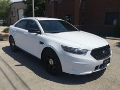Car brand auctioned: Ford Taurus POLICE INTERCEPTOR 2014 Car model ford taurus police interceptor very clean awd only 31 k miles no reserve
