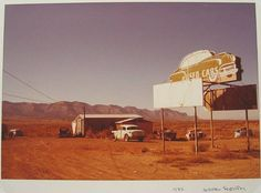 William Eggleston, Untitled (Used Cars on Auto-shaped Neon Sign) from the Los Alamos Project 1972