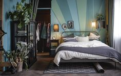 A bedroom is styled as a modern take on Art Nouveau