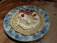 A pancake face made with whipped cream, glace cherries and a little Caroline's Dairy Belgian Choc ice cream hair!