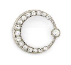 A diamond circle brooch of moon and star motif