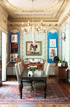 Très chic! The ceiling, the gramophone, the teal, the table, the maiden form . Ahhh.