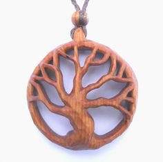 Hand carved wooden pendants in a wide range of recycled woods. Buy online.