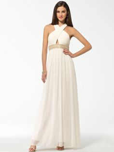 We love the Grecian goddess glamour of this floor-skimming gown embellished with a pearl and bead encrusted waist and a peek-a-boo keyhole.Criss cross pleated halterKeyhole at bustPearl and beaded embellishment at ...