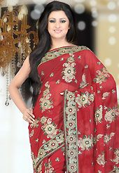 Make a trendy look with this classic embroidered saree. This dark red faux georgette saree have beautiful embroidery patch work which is embellished with resham, zari, sequins, stone and cutdana work. This saree gives you a modern and different look in fabulous style. Matching blouse is available. Slight Color variations are possible due to differing screen and photograph resolutions.