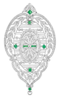 A Belle Epoque Platinum, Diamond and Emerald Pendant-Brooch. The fancy-shaped openwork filigree brooch within a garland frame, set with numerous old-mine and rose-cut diamonds, accented by small square-cut emeralds, circa 1910. #BelleÉpoque #pendant #brooch