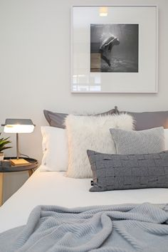 Master bedroom, grey cushions, black and white art, white linen, faux fur cushion, monochromatic styling