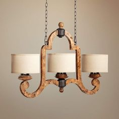 three light island chandelier features a Provincial wood grain finish and oatmeal linen drum shades