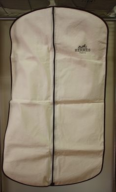 New HERMES Natural Cotton Garment Bag with HERMES Logo! at Rice and Beans Vintage http://www.riceandbeansvintage.com/NewArrivals.html