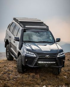 For this special Lexus LX 570 J201 Concept, a blower takes things to 550 hp, and it's outfitted by Expedition Overland. Lexus Lx570, Trailer Hitch, Automotive News, Ducati Models, Car And Driver, Roof Rack, Off Road Wheels, Toyota Land Cruiser, Autos
