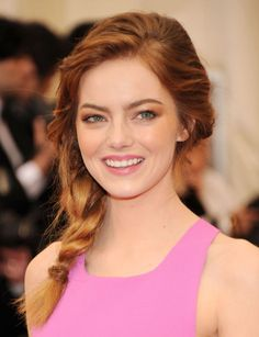 Emma Stone's plait is ideal for both sophisticated and low-key beach weddings. Consider removable extensions to give your braid extra volume.