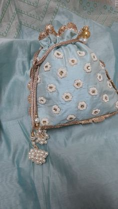 Beautiful sea green shade and complimentary pearl work. We love the bunch of pearl tassels