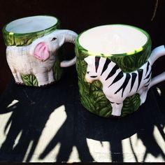 Elephant and zebra coffee mugs, that's wild. #theclutterhouse #localaz #coffee #elephant #zebra