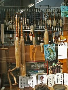 Ginormous calligraphy brushes in store window in Seoul  photo by DJ Brewer