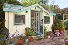 With multi-paned windows and board-and-batten siding, this sweet shed looks more like a cottage than a hard-working gardening outpost. | Photo: Mark Lohman | thisoldhouse.com