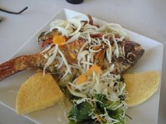 Fried Fish With Fried Bammy.....    If you are visiting Jamaica one of the best places to get our famous fried, steamed, brown stewed or escoveitched fish with bammy or rice is Gloria's in Port Royal. Even as a yardie every time I go to Jamaica I make it a point to go there and get me some fried fish 