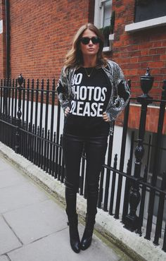 Made in Chelsea's Millie Mackintosh wears a 'No Photos Please' slogan T-shirt as she models clothes for her fashion dairy.