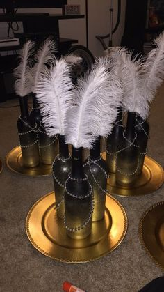 Great Gatsby inspired centerpiece. Wine bottles with ombre color atop a matching plate. Great for weddings or your dining room table. Available in custom colors and feathers. Made to order. Just let me know what you are looking for and I can always adjust them. I am using these for my own wedding centerpieces. I use different shaped wine bottles, clean them, spray them down, color the ombre, add the beads/feathers: get a simple and elegant centerpiece. Will do bulk. By two sets, get 3rd…