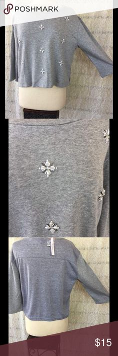 Gray Sweater Embroidered With Pearl Beads This sweet little sweater is a size Medium. Very soft and Embroidered with pearl and silver beads in the shape of flowers (come with extra beads) The gray I the back of the sweater is a different gray as seen in photo 3. NWT Measurements upon request. Please ask any questions below! & I always consider offers! Sweaters Crew & Scoop Necks