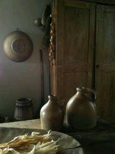 Stoneware crock jugs and wood.