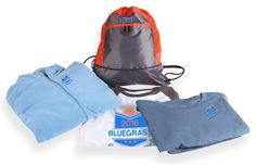 Jacket: Style1706 in Sport Light Blue; Shirt 1: Style 1616 in White/Charcoal Blend; Shirt 2: Style 1615 in Lake; Cinch Bag: Style 1221 in Pop Orange/Deep Smoke.
