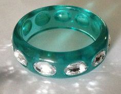 Hey, I found this really awesome Etsy listing at https://www.etsy.com/listing/196970627/vintage-lucite-bangle-bracelet