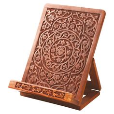 Your books and tablets will stand tall in this Hand-Carved Rosewood Tablet and Book Easel. This versatile tablet holder props up your recipe books, e-reader, favorite novels, Sunday paper or go-to mag